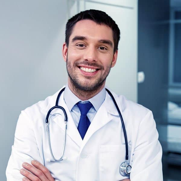 smiling doctor with stethoscope at hospital PVS8FJU